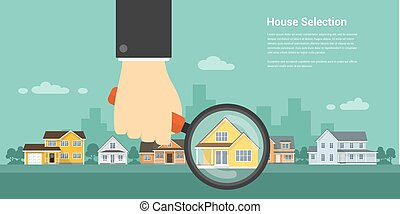 house selection concept - picture of a human hand holding...