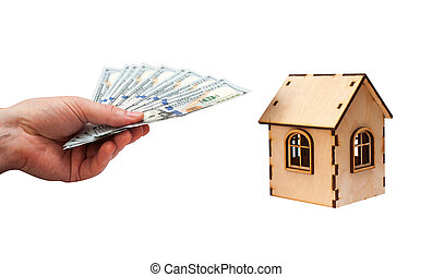 House shape made of wooden blocks and currencies dollar with man hand