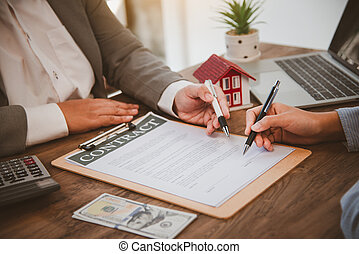 House signers signing signature loan document to home ownership with real estate agents ownership. Mortgage and real estate property investment, home insurance