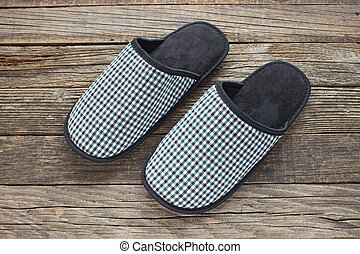 House slippers on wooden old floor
