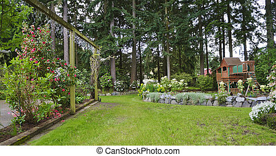 House spring backyard with roses patio and kids playground....