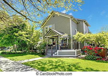 House spring grey exterior with entrance porch.