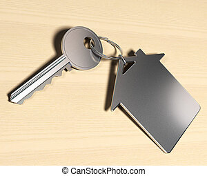 house symbol keyring and a key over a wooden background,...