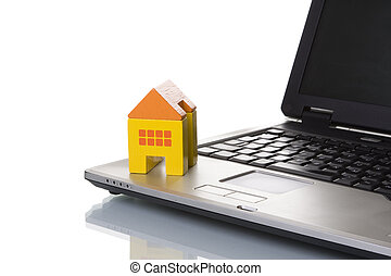 House toy over a laptop