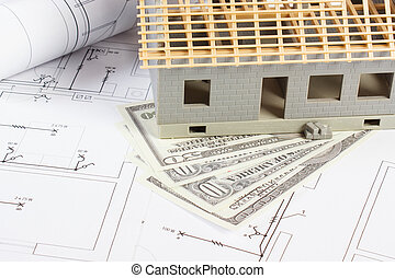 House under construction and currencies dollar on electrical drawings and diagrams for project, building home cost concept