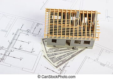 House under construction and currencies dollar on electrical drawings, concept of building home