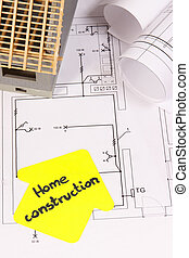 House under construction and electrical diagrams for use in engineer jobs, building home concept