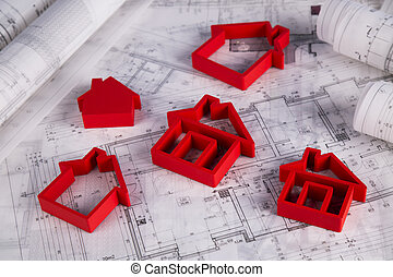 House under construction, blueprints concept