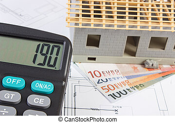 House under construction, calculator and currencies euro on electrical drawings, concept of building home