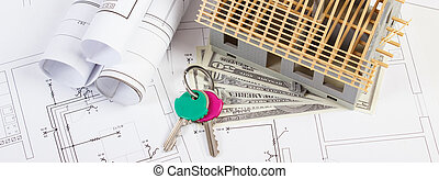 House under construction, currencies dollar and keys on electrical drawings and diagrams for project, building home cost concept