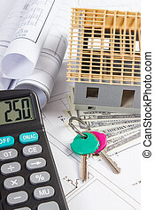 House under construction, keys, calculator, currencies dollar and electrical drawings, concept of building home