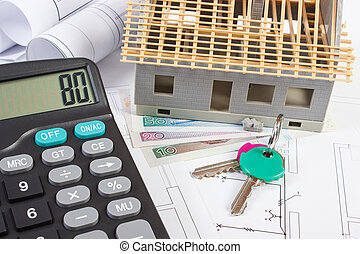 House under construction, keys, calculator, polish currency and electrical drawings, concept of building home