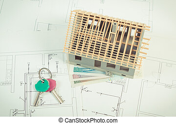 House under construction, polish currency money and keys on electrical drawings and diagrams for project, building home cost concept
