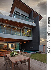 house - View of nice modern villa in summer after sunset ...