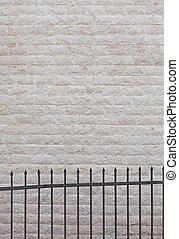 house wall faced with natural stone tiles