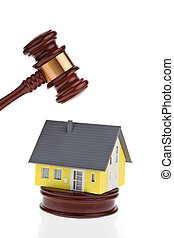 A house is auctioned. Foreclosure and insolvency. Personal bankruptcy.