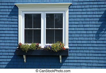 A Colourful Shingled House With Window And Window Box