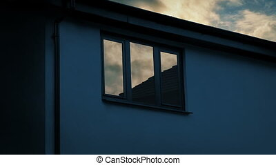 House Window Reflecting Sunrise - Typical house with morning...