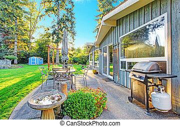 House with backyard patio area