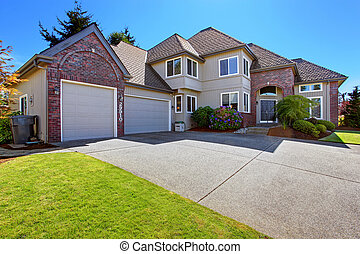 House with brick trim and curb appeal