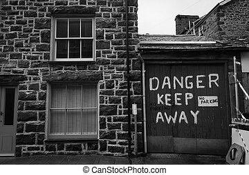 House with danger keep away sign that reminded me of a...