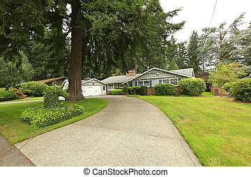 House with driveway and landscape - House exterior with...