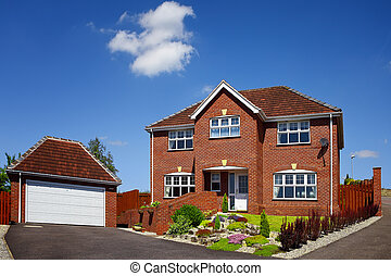House with garage on a blue sky