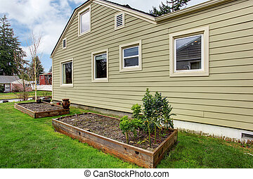 House with garden beds