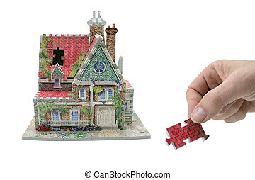 house with hand and missing piece