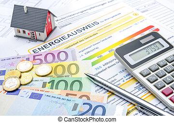 Energy saving - House with money and calculator. Energy...