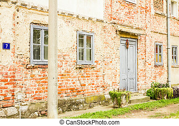 House with old brick wall