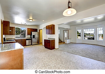 House with open floor plan. Empty living and kitchen room
