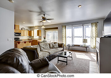 House with open floor plan. Family room and kitchen area