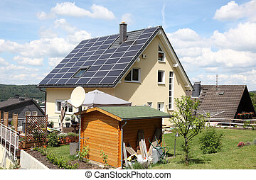 House with photovoltaic panels on the roof