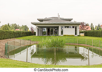 House with pond