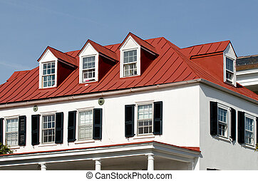 House with red roof and dormer windows