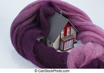 house with scarf. symbolfoto heat insulation - a model house...