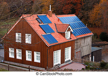 Historic farm house with modern solar electric and solar heating system on large roof.