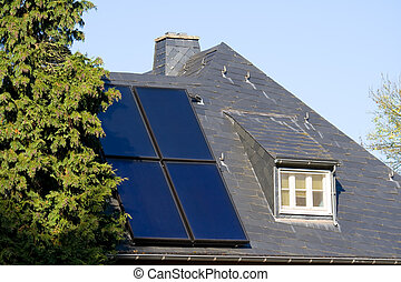 House with solar (photovoltaic) panels