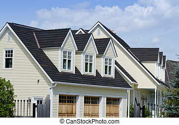 House with thre dormers and triple garage