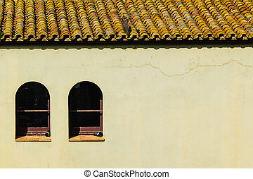 House with tile roof and two Windows