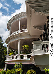 House with Two-Story Round Veranda