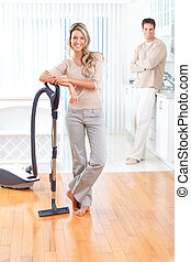 House work, vacuum cleaner, young couple, home, kitchen. ...