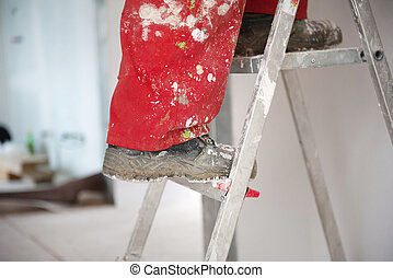 House worker - Detail of builder shoe on the ladder