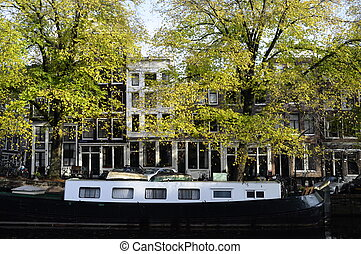 Houseboat and architecture in old city of Amsterdam in ...