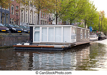 Houseboat - Living near the shore barge on the canal in ...