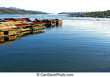 Houseboat on blue water