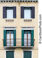 Housefront with Window Shutters - The front facade of a...