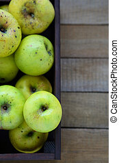 household apples in wooden crate, top view