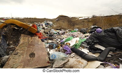 Household garbage illegally dumped on the side of the road....